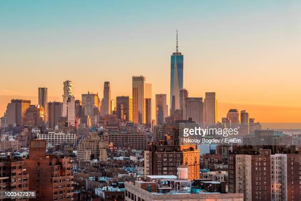 modern buildings in city against sky during sunset - one world trade center stock pictures, royalty-free photos & images