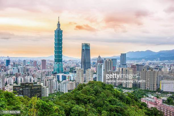 modern buildings in city against sky during sunset - taipei stock pictures, royalty-free photos & images