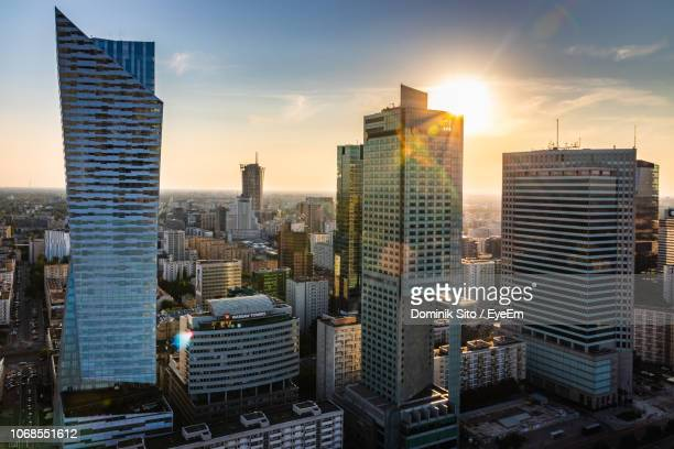 modern buildings in city against sky during sunset - warsaw stock pictures, royalty-free photos & images