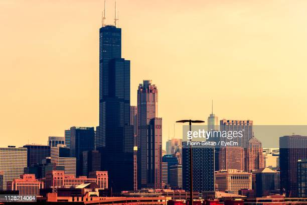 modern buildings in city against sky during sunset - florin seitan stock pictures, royalty-free photos & images