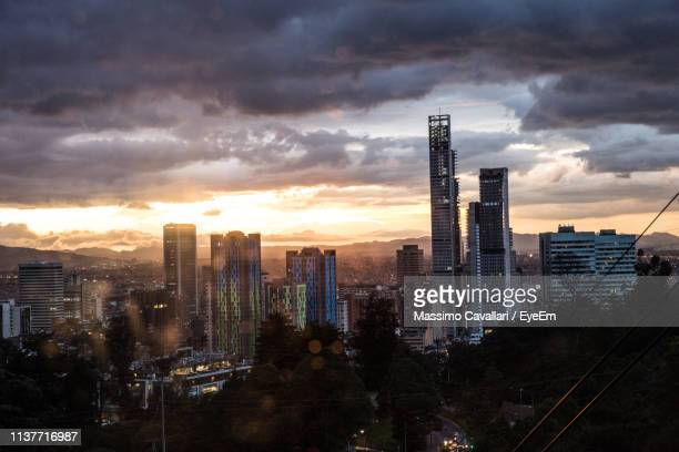 modern buildings in city against sky during sunset - bogota stock pictures, royalty-free photos & images