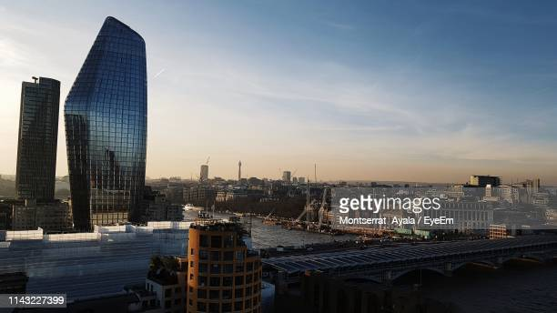modern buildings in city against sky during sunset - greater london stock pictures, royalty-free photos & images