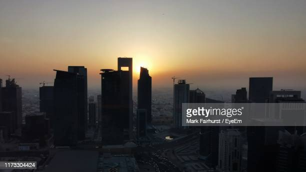 modern buildings in city against sky during sunset - doha stock pictures, royalty-free photos & images