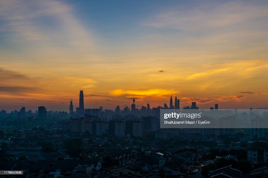 Modern Buildings In City Against Sky During Sunset : Stock Photo