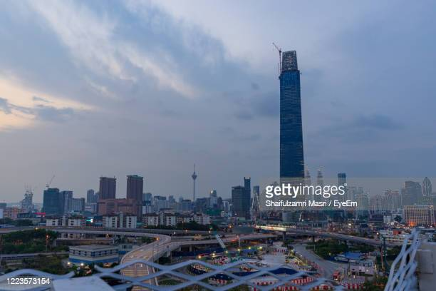 modern buildings in city against sky during sunset - shaifulzamri stock pictures, royalty-free photos & images