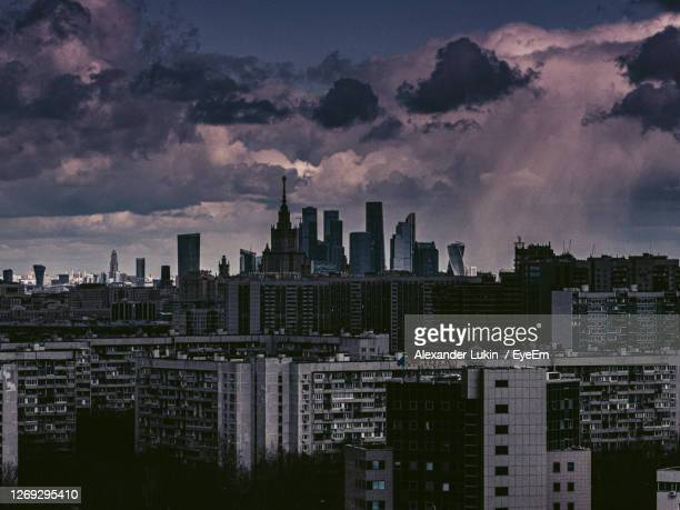 modern buildings in city against sky during sunset - moscow russia stock pictures, royalty-free photos & images