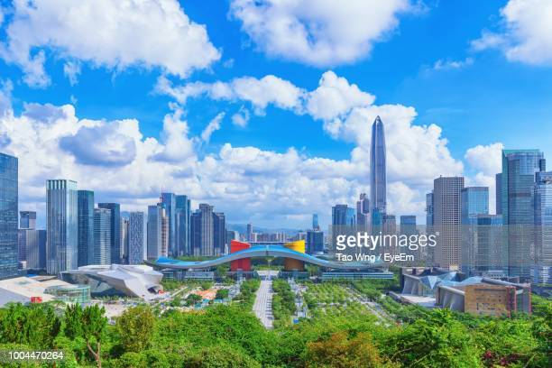 modern buildings in city against sky - shenzhen stock pictures, royalty-free photos & images