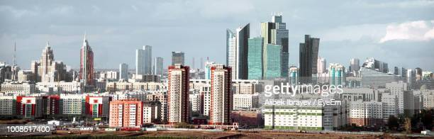 modern buildings in city against sky - astana stock photos and pictures