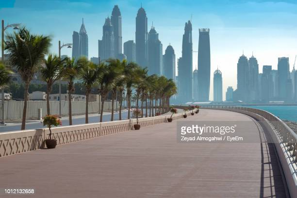 modern buildings in city against sky - dubai stock pictures, royalty-free photos & images
