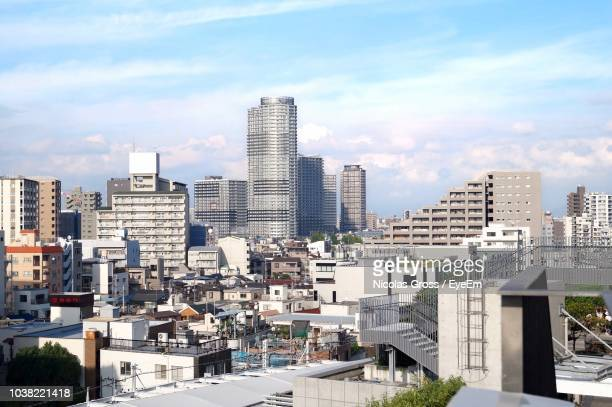 modern buildings in city against sky - 昼間 ストックフォトと画像