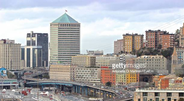 modern buildings in city against sky - genoa italy stock pictures, royalty-free photos & images