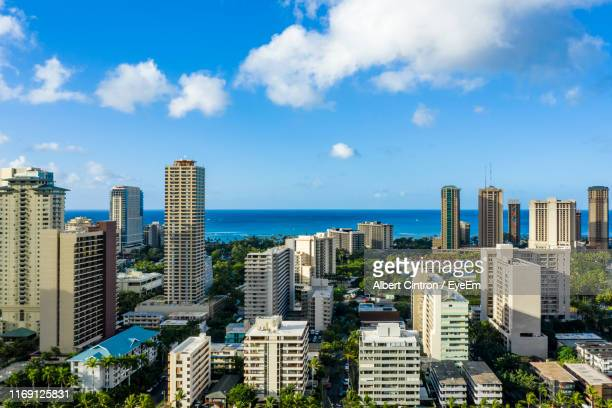 modern buildings in city against sky - waikiki stock pictures, royalty-free photos & images