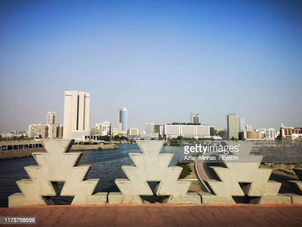 modern buildings in city against sky - jiddah stock pictures, royalty-free photos & images