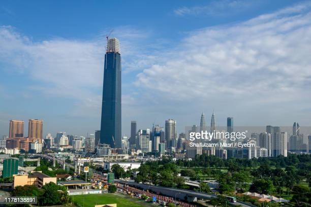 modern buildings in city against sky - shaifulzamri stock pictures, royalty-free photos & images