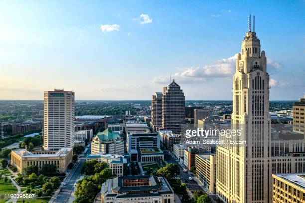 modern buildings in city against sky - columbus ohio stock pictures, royalty-free photos & images