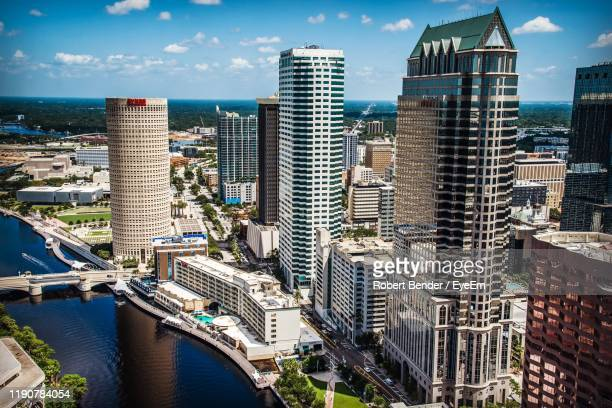 modern buildings in city against sky - tampa stock pictures, royalty-free photos & images