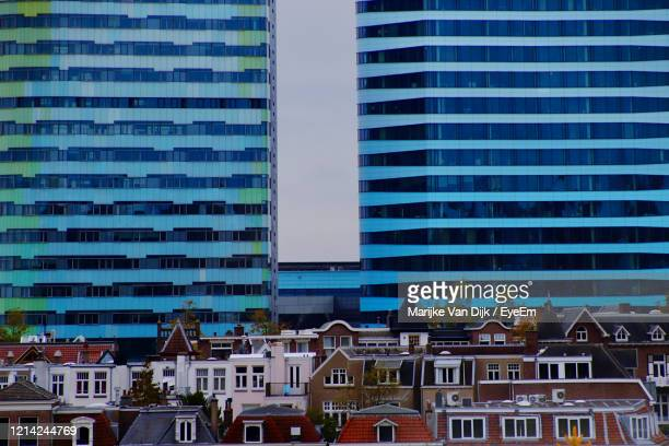 modern buildings in city against sky - van dijk stock pictures, royalty-free photos & images