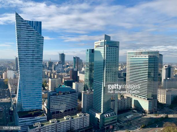modern buildings in city against sky - warsaw stock pictures, royalty-free photos & images