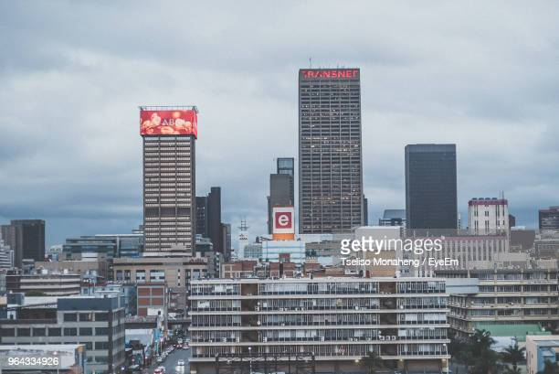 modern buildings in city against sky - gauteng province stock pictures, royalty-free photos & images