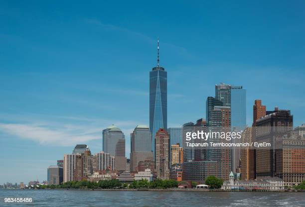 modern buildings in city against sky - one world trade center stock pictures, royalty-free photos & images