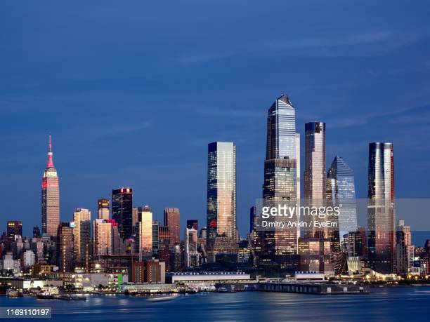 modern buildings in city at waterfront - hudson yards stock pictures, royalty-free photos & images