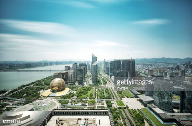 modern buildings near water in midtown of modern city - hangzhou stock pictures, royalty-free photos & images