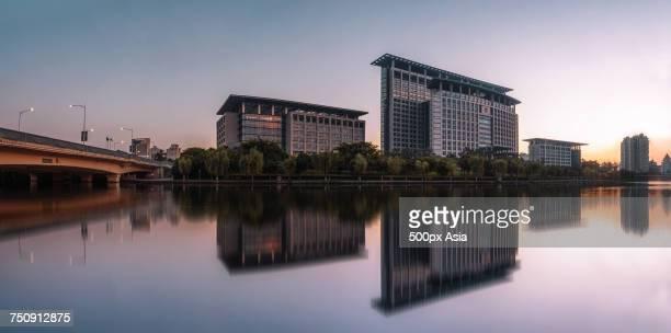 """""""Modern buildings reflecting in river, Wenzhou, Zhejiang, China"""""""