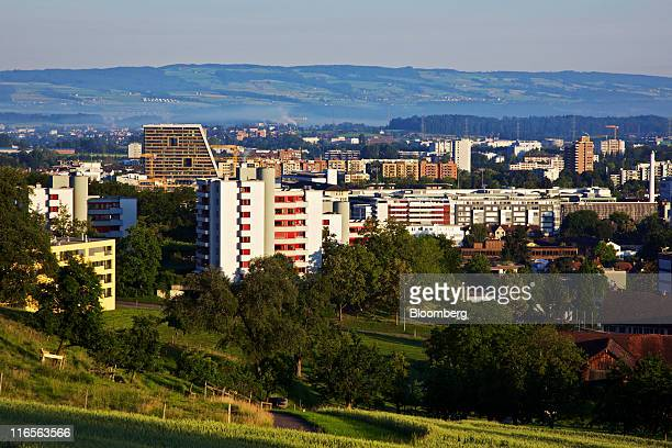 Modern buildings rest in the town of Zug Switzerland on Wednesday June 15 2011 Zug is home to the registered headquarters of some of the world's...