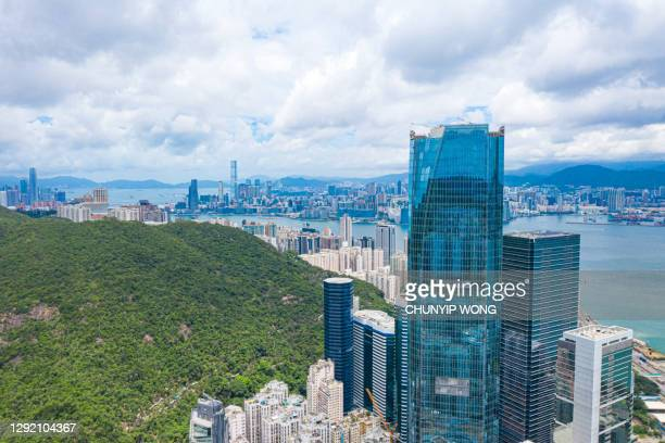 modern business building in hong kong - china east asia stock pictures, royalty-free photos & images