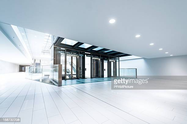 modern business hall lifts - hotel lobby stock pictures, royalty-free photos & images