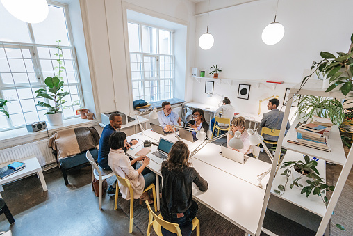 Modern business office with multi-ethnic team 1042569776
