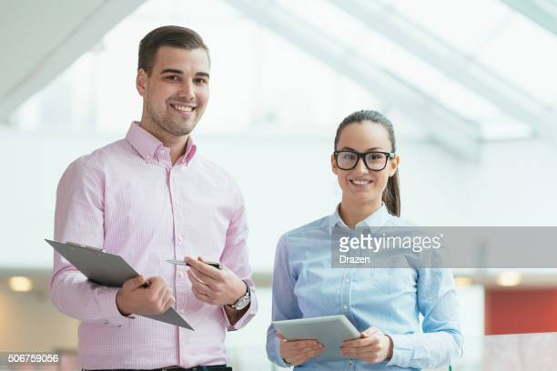 Modern business people in office building having business meeting