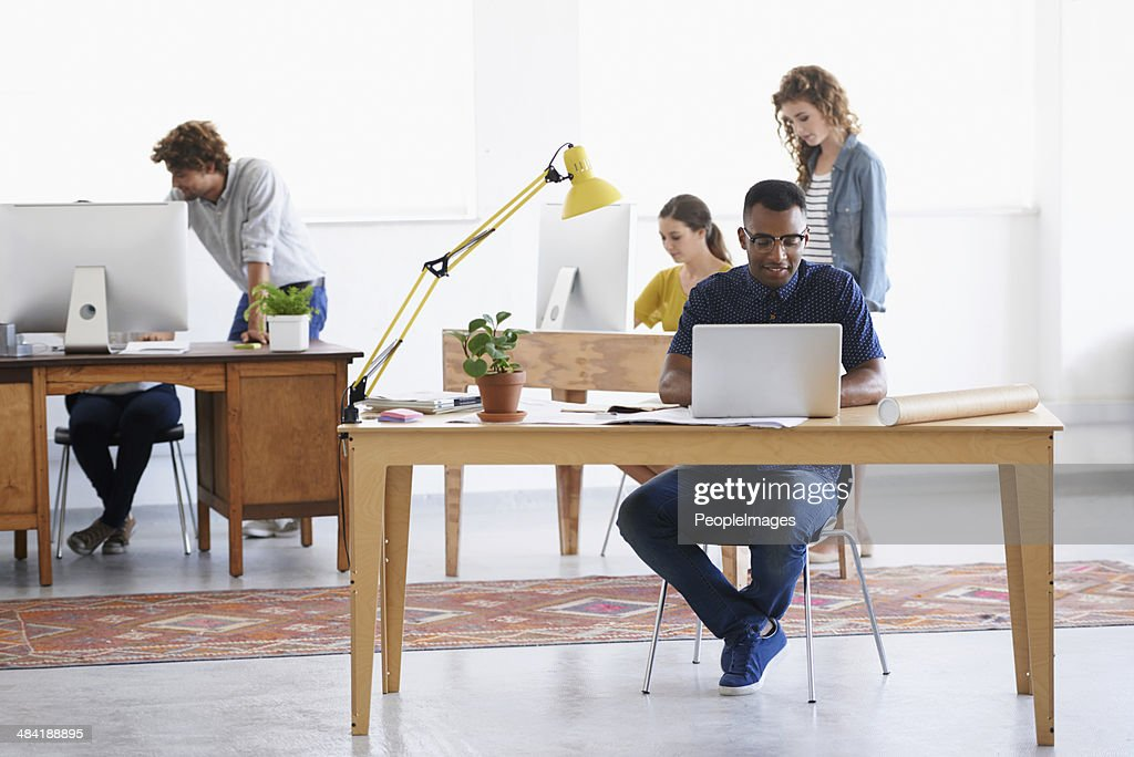 Modern business: Young, trendy and totally creative! : Stock Photo