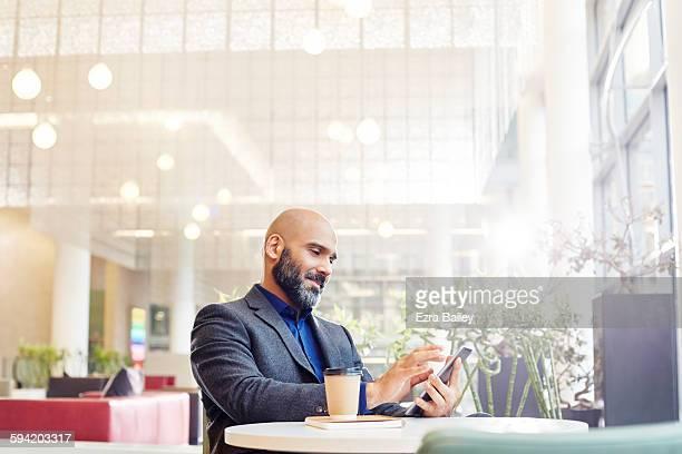 Modern businessman checking his phone.
