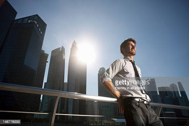 Modern businessman in city, smiling