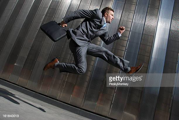 Modern Businessman Jumping Office Building City Sidewalk