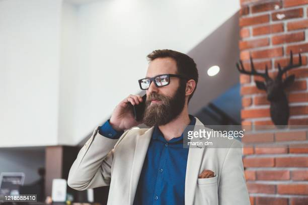 modern businessman on the phone - financial analyst stock pictures, royalty-free photos & images