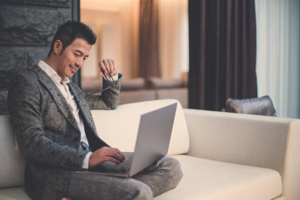 modern businessman using laptop - asian man professional stock pictures, royalty-free photos & images