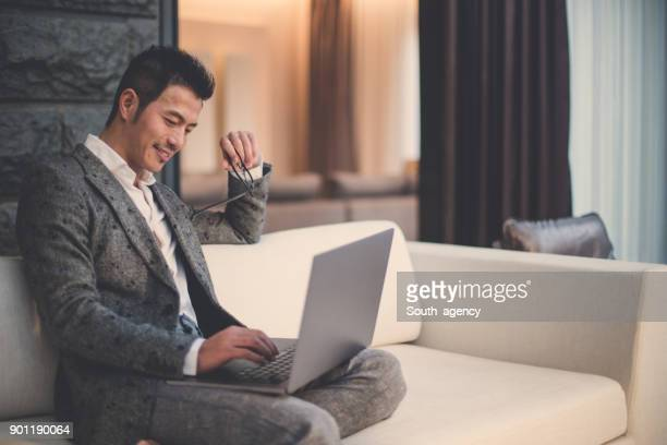 modern businessman using laptop - asian and indian ethnicities stock pictures, royalty-free photos & images