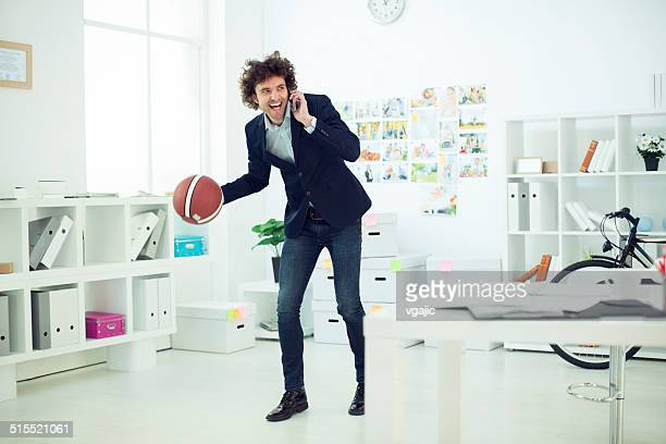 Modern Businessman with basketball in office.