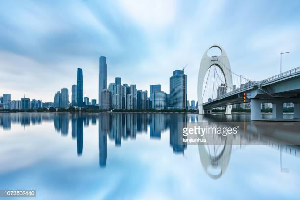 modern cable-stayed bridge over pearl river with guangzhou cbd in the background - guangzhou stock pictures, royalty-free photos & images