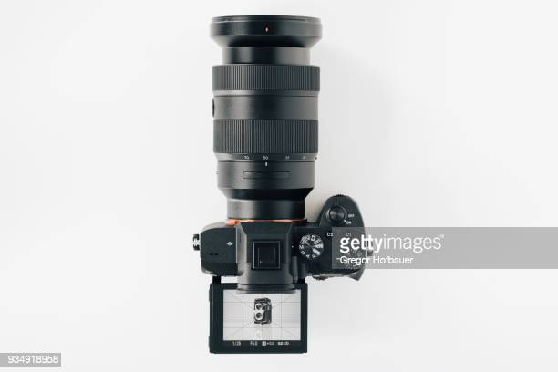 modern camera looks at vintage camera - digital camera stock pictures, royalty-free photos & images