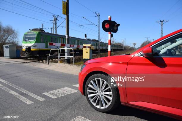 modern car waiting on the railroad crossing - railroad crossing stock pictures, royalty-free photos & images