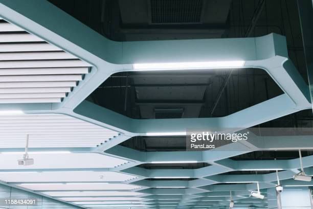 modern ceiling with security camera - business security camera stock pictures, royalty-free photos & images