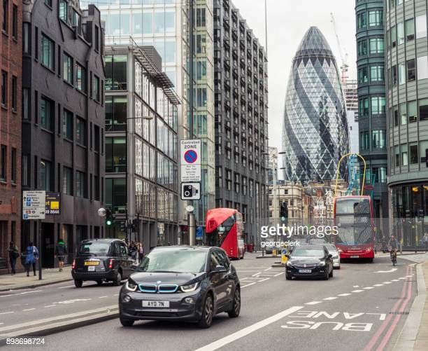 modern central london traffic - bmw stock pictures, royalty-free photos & images