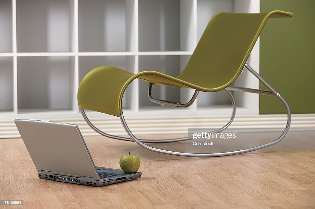 Modern Chair with laptop and apple : Stockfoto