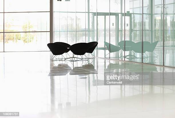 modern chairs at a spacious modern lobby - focus on foreground stock photos and pictures