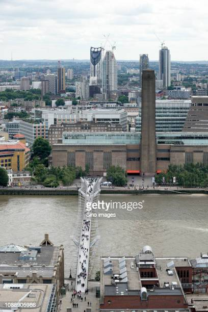 modern city and bridge on river, england, uk - image stock pictures, royalty-free photos & images