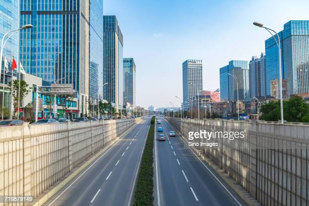 modern city and street on sunny day, wuhan, china - wuhan stock photos and pictures