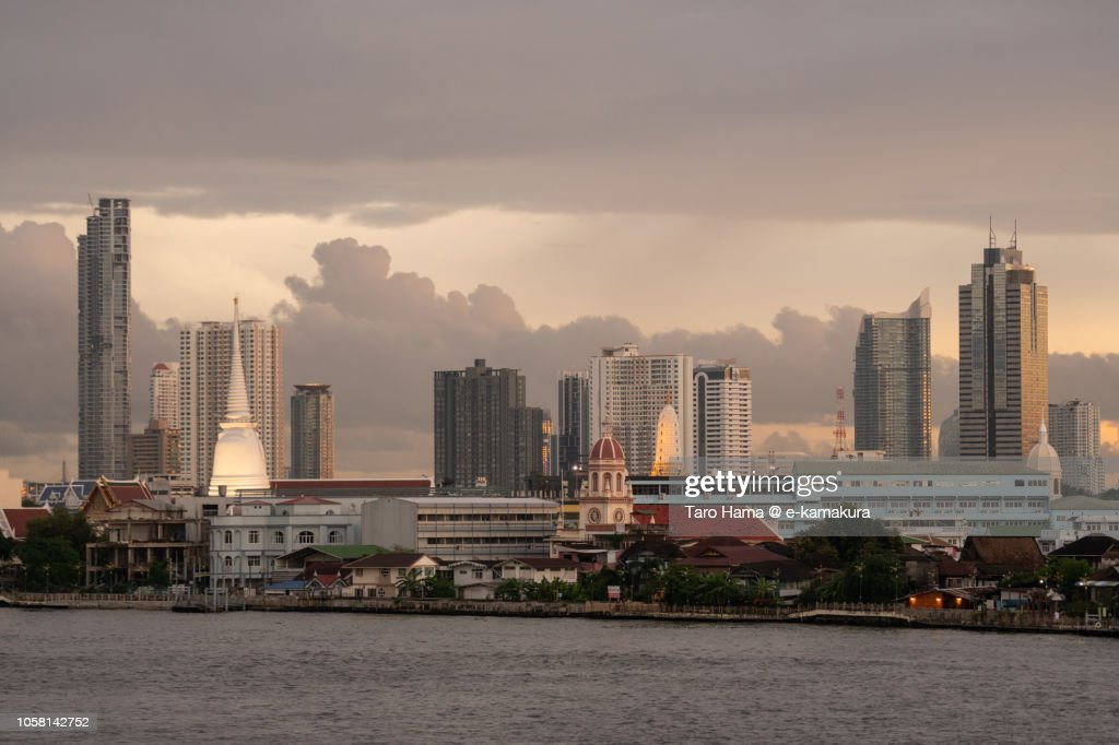 Modern city buildings and Chao Phraya River in Bangkok in the sunset : Stock Photo